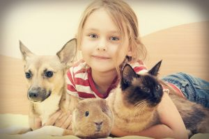 young girl with her dog, cat & pet guinea pig